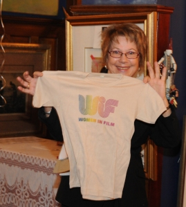 Ginny Durrin, former WIFV president, holds up the first ever WIFV tee-shirt--printed when WIFV was founded in 1979.  Durable AND fashionable apparel?  Just one of the many wonderful things WIFV has to offer.