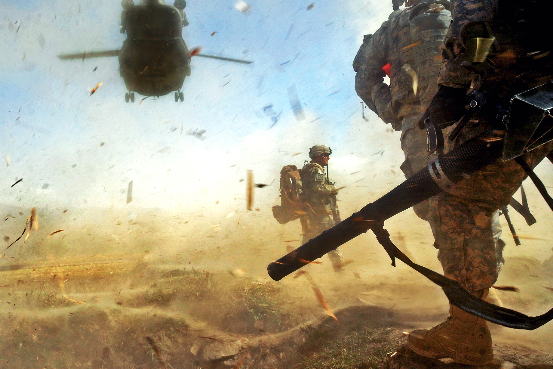 PAKTIKA PROVINCE, Afghanistan – Paratroopers from 3rd Platoon, Company B, 3rd Battalion, 509th Parachute Infantry Regiment, 4th Brigade Combat Team, 25th Infantry Division prepare to load a CH-47 Chinook Helicopter in the Bermel District of the Paktika province in eastern Afghanistan, Oct. 13, during an air-assault mission to detain a known militant. (Photo by U.S. Army Pfc. Andrya Hill, 4th Brigade Combat Team, 25th Infantry Division Public Affairs)