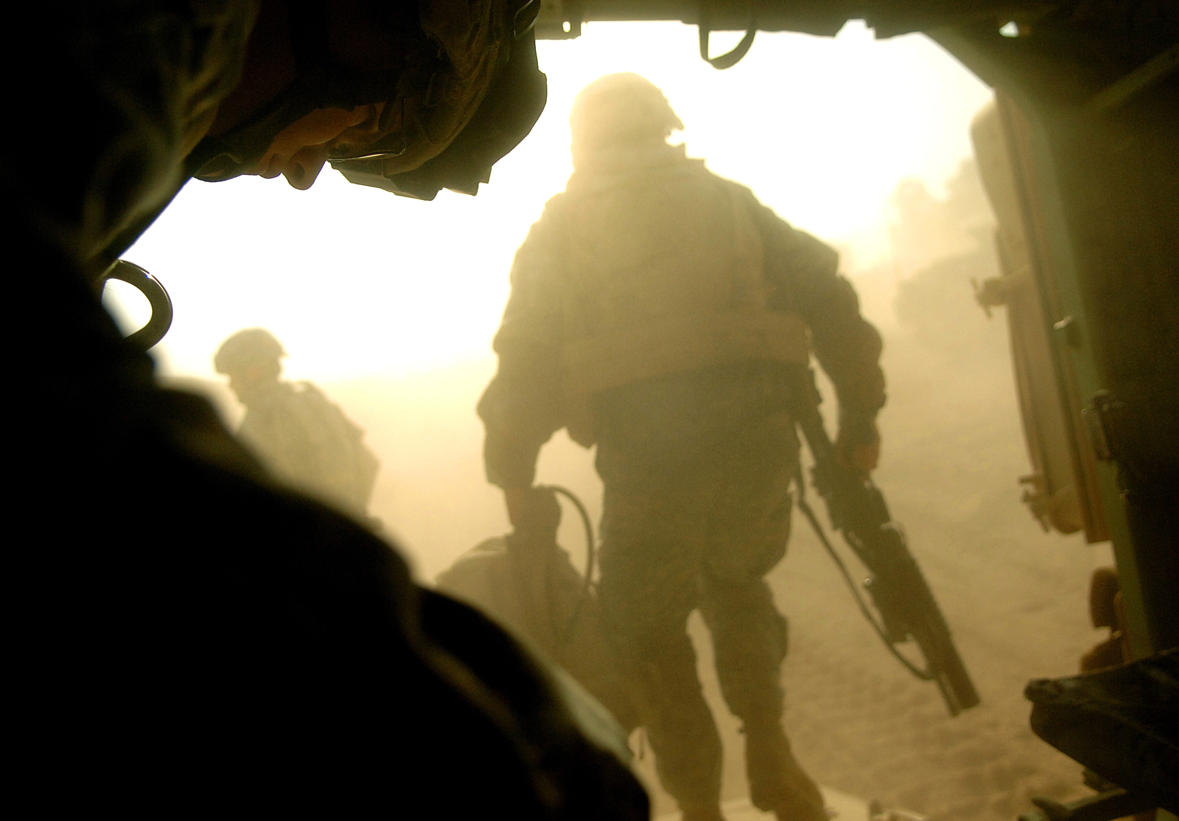 060903-F-1644L-058 U.S. Army Spc. Jeffery Moore (left) prepares to exit an M 2 Bradley fighting vehicle at Camp Ar Ramadi, Iraq, following a raid in the Tameem district of Ramadi, Iraq, on Sept. 3, 2006.  Moore is assigned to Bravo Company, 2nd Battalion, 6th Infantry Regiment, 1st Armored Division.  DoD photo by Tech. Sgt. Jeremy T. Lock, U.S. Air Force.  (Released)