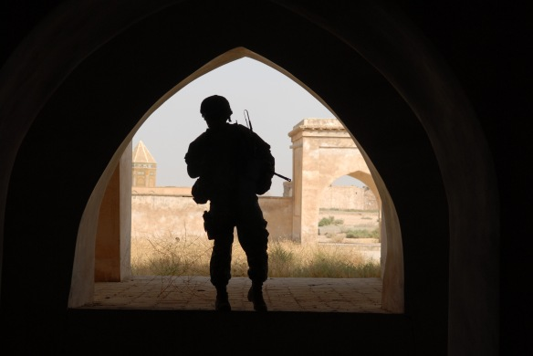 071015-F-7418E-136Army 2nd Lt. Andrew Archer is framed by an arch at the citadel in Kirkuk, Iraq, on Oct. 15, 2007.  Archer, of Delta Company, 2nd Battalion, 22nd Infantry Regiment, 1st Brigade Combat Team, 10th Mountain Division and civilians from the Kirkuk Provincial Reconstruction Team toured the historic site in Kirkuk.  DoD photo by Staff Sgt. Dallas Edwards, U.S. Air Force.  (Released)